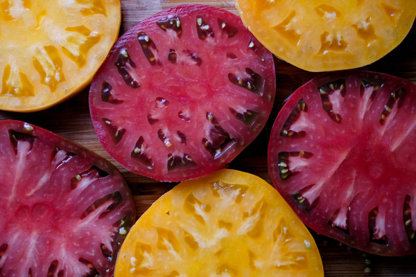 Sliced heirloom tomatoes (orange and red)