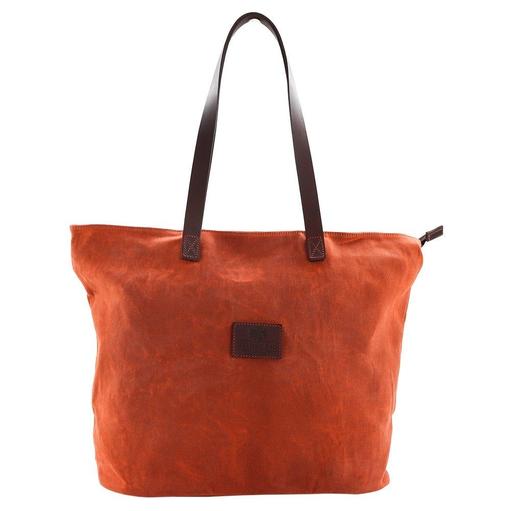This bright canvas tote bag is a stylish colour pop of orange. Need the perfect travel accessory? Shop at Eclectic Hound for high-quality, gorgeous travel luggage. Click to view the stunning collection.