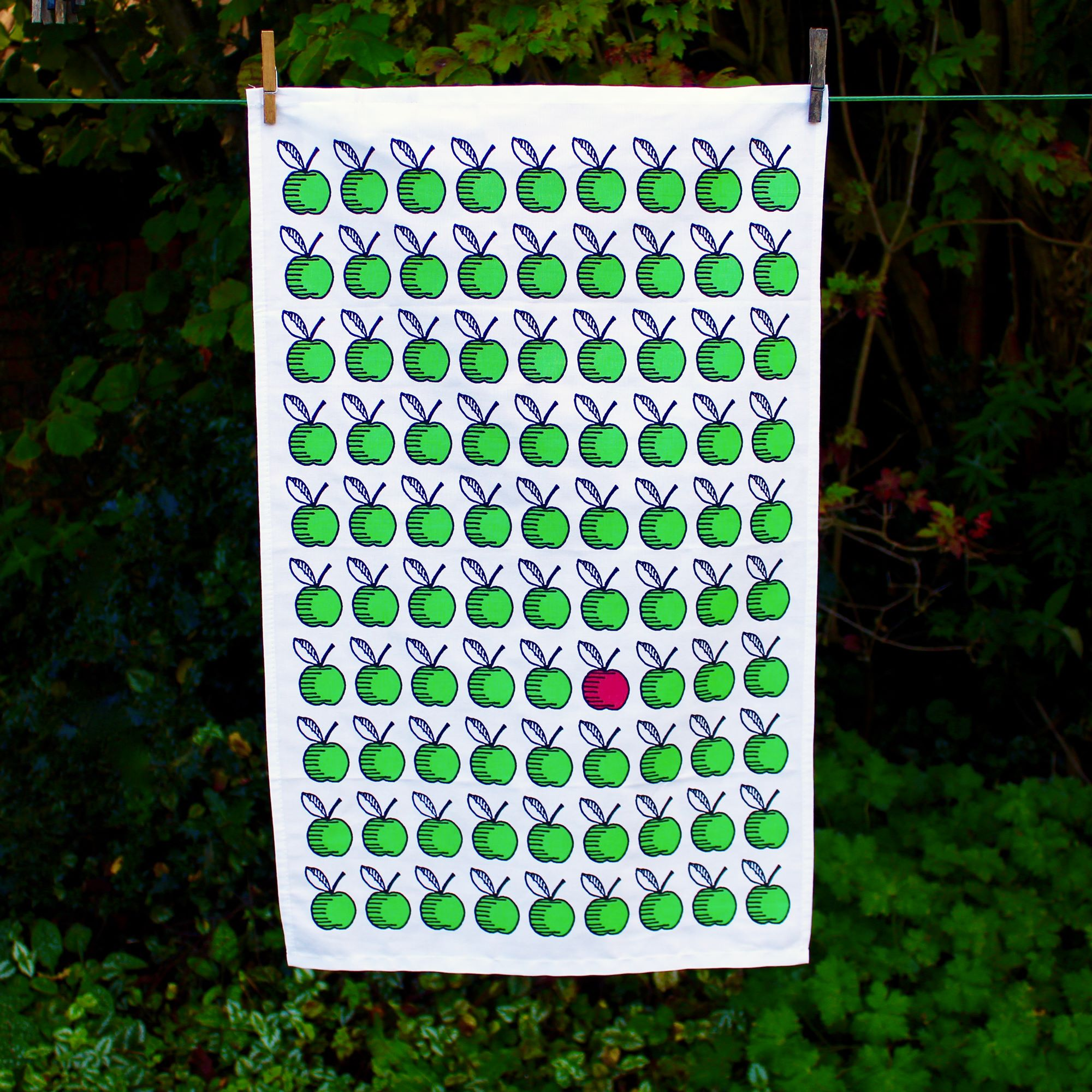 A striking tea towel from Lime Tree Design featuring apples in green on a white background. Our wonderful home accessories will compliment your home beautifully. Find the perfect homewares today at Eclectic Hound in Winchester.