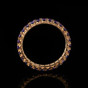 purple sapphire and rose gold eternity ring fishtail set
