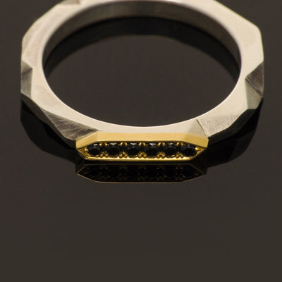 silver and gold band with black diamonds