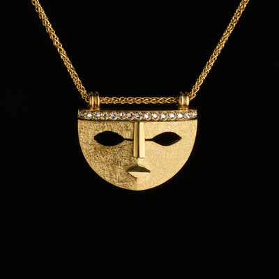 aztec inspired gold mask pendant with diamonds