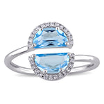 1/10 CT TW Diamond and Blue Topaz Bypass Ring in 14k White Gold