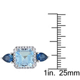 1/7 CT TW Diamond and 3 3/4 CT TGW Cushion Cut Blue Topaz Halo Ring in Sterling Silver