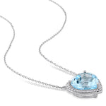 6 4/5 CT TGW Heart Shaped Blue Topaz and 1/5 CT TW Diamond Halo Pendant with Chain in 14k White Gold
