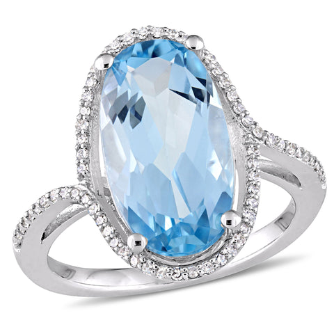 8 CT TGW Oval Cut Blue Topaz and 1/5 CT TW Diamond Halo Ring in 14k White Gold