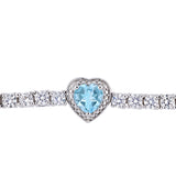 8-1/2 CT TGW Sky-Blue Topaz and Created White Sapphire Stationed Halo Heart Tennis Bracelet in Sterling Silver