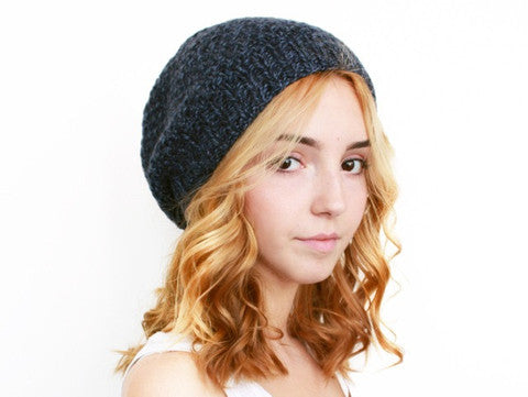 fadb8b64766 It s a classic unisex stockinette hat with a ribbed edge and a slight slouch .