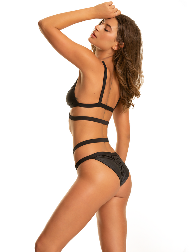 side angle model wearing strap black bikini set
