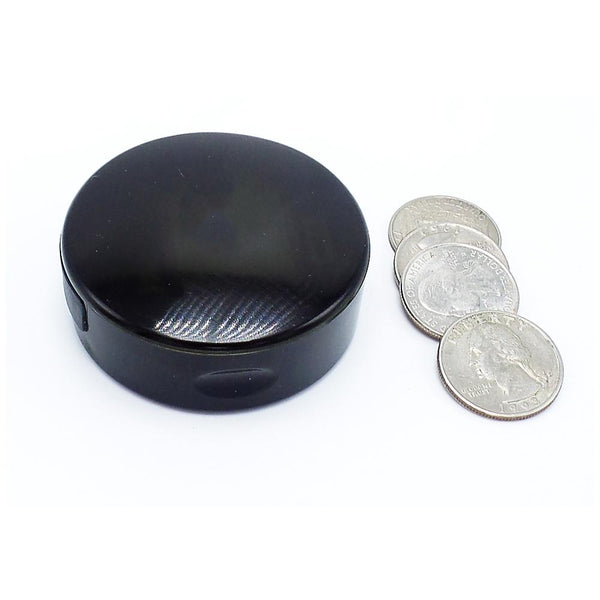 tiny tracking device next to quarters
