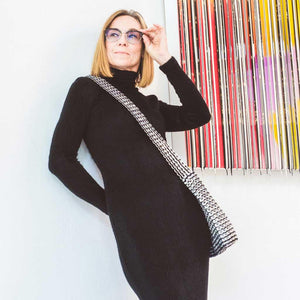 "alt=""black and white striped crossbody purse worn by woman in black turtleneck, eco fashion by Escama Studio"""
