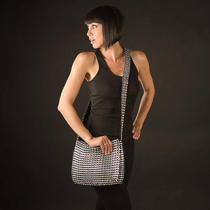 "alt=""black crossbody purse with flap worn by woman in black, eco fashion from Escama Studio"""