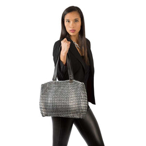 "alt=""black tote worn by woman in black jacket and pants, Kate bag by Escama Studio"""