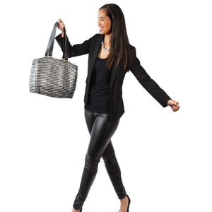 "alt=""black tote from recycled materials held by smiling woman in black, Kate bag by Escama Studio"""