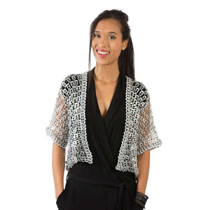 "alt=""bolero jacket for women with pop tab sequins worn by smiling woman in black dress, by Escama Studio"""