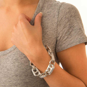 "alt=""recycled bracelet chain worn by woman in gray shirt, Escama Studio"""