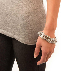 "alt=""10th anniversary gift recycled aluminum bracelet worn by woman in gray shirt, Escama Studio"""