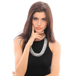 "alt=""cleopatra egyptian necklace from soda tabs worn by woman in sleeveless black dress"""