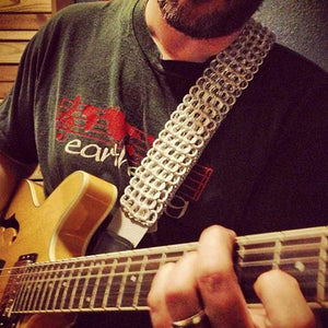 "alt=""cool silver guitar strap that looks like metal with Gibson semi hollow body guitar player"""