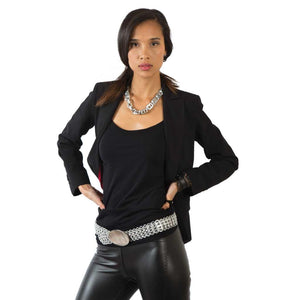 "alt=""metallic silver belt worn by woman in black leather pants, Sandra pop tab belt by Escama"""