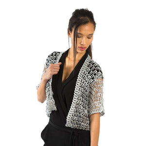 "alt=""bolero jacket handmade with recycled pop tabs worn by woman in black wrap dress, Escama Studio"""