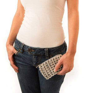 "alt=""silver coin purse made of aluminum pop tabs held by woman in jeans, by Escama Studio"""