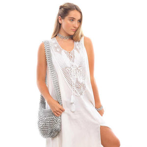 "alt=""silver cross body bag from recycled materials worn by girl in white lace dress, Greta crossbody by Escama Studio"""