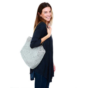 "alt=""silver woven tote made of recycled pop tabs worn by smiling woman, Kate tote by Escama Studio"""
