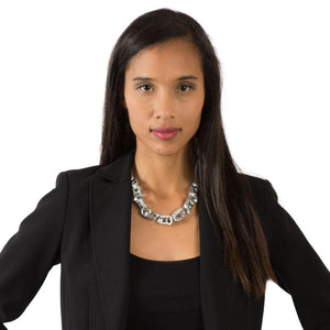 "alt=""recycled jewelry chain necklace worn by woman in black blazer jacket, escama studio"""