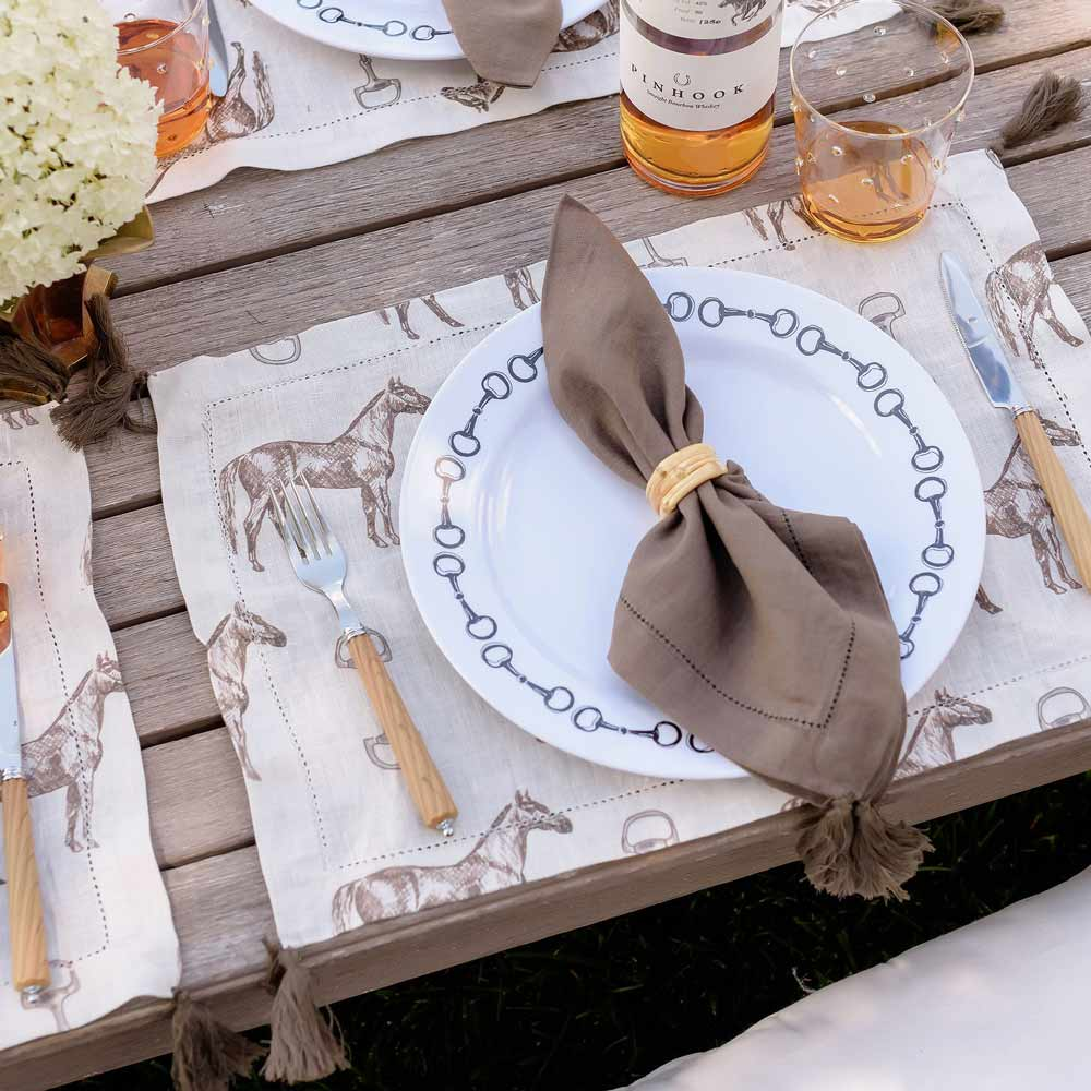 brown linen napkin with tassel and bamboo napkin ring