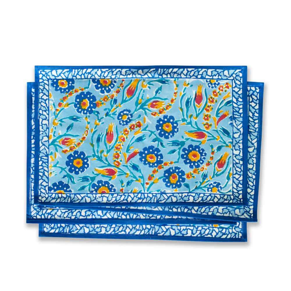 cloth placemats with vibrant blooms of red, yellow, and blue.