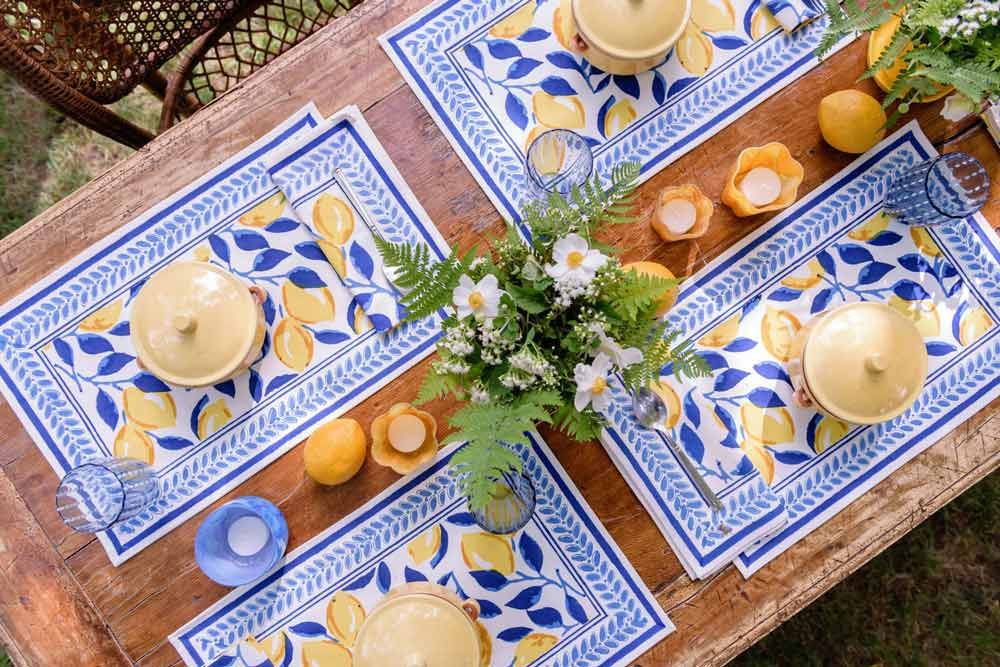 Table with lemon and navy placemats