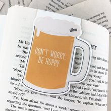 "Load image into Gallery viewer, nerdy hipster beer bug laminated magnetic bookmark back with words ""don't worry, be hoppy"""