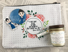 "Load image into Gallery viewer, Jane Austen themed gift set featuring pocket mirror, laminated magnetic bookmark, limoncello lip balm, Pemberly gardens candle, and zip up pouch with the quote ""it isn't what we say or think that defines us, but what we do"""