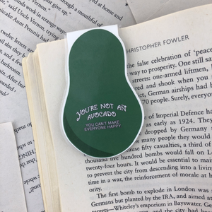 "back of avocado bookmark reads ""you're not an avocado you can't make everyone happy"""