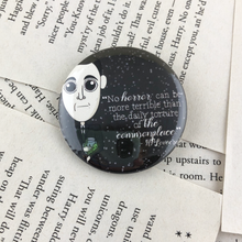 "Load image into Gallery viewer, HP Lovecraft pinback button or magnet with quote ""no horror can be more terrible than the daily torture of the commonplace"""