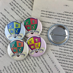 "set of four creative crest pin back buttons reading ""choose your weapon"""