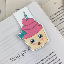 Load image into Gallery viewer, laminated magnetic bookmark featuring a pink cupcake with a green bow and a birthday candle
