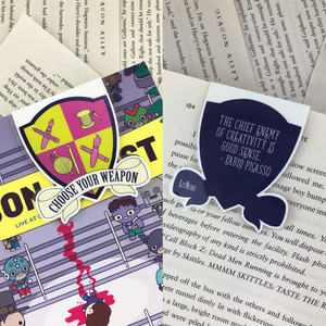 "purple and green creative crest laminated magnetic bookmark reading ""choose your weapon"" on front and ""the chief enemy of creativity is good sense"" on back"