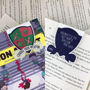 "pink and green creative crest laminated magnetic bookmark reading ""choose your weapon"" on front and ""originality is the best form of rebellion"" on back"