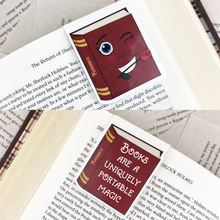 "Load image into Gallery viewer, red romance laminated magnetic bookmark with words ""books are a uniquely portable magic"""