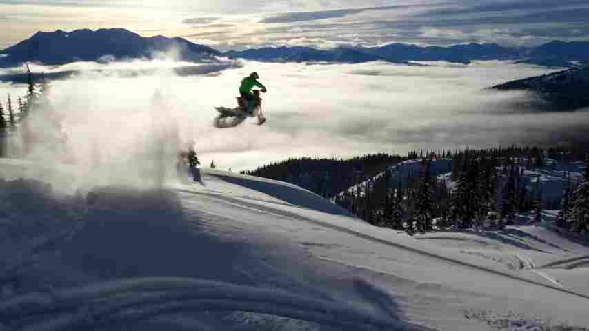 Darren Berrecloth hops on a motorizedsnowbike to do some backcountry freeriding in BC.
