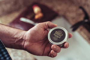 Man Holding Tin Of Beard Butter Conditioner Whiskey N Hardtack