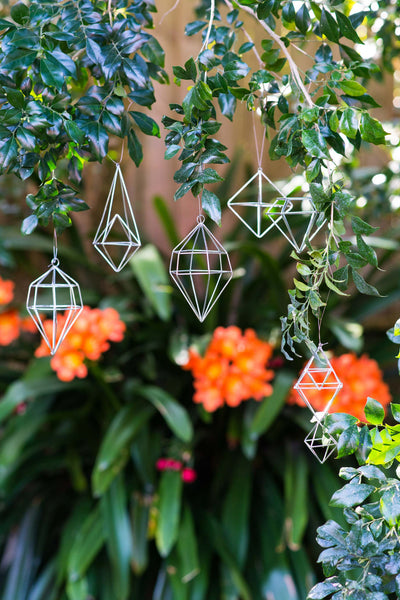 6 PIECE SILVER GEOMETRIC DECORATIONS