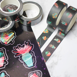 Japanese paper tape that is black with a pattern of cacti and one with a pattern of witch related items.
