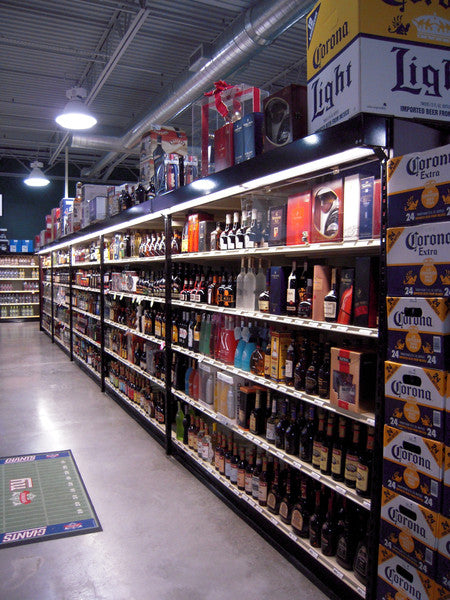 liquor store shelving with overhead storage