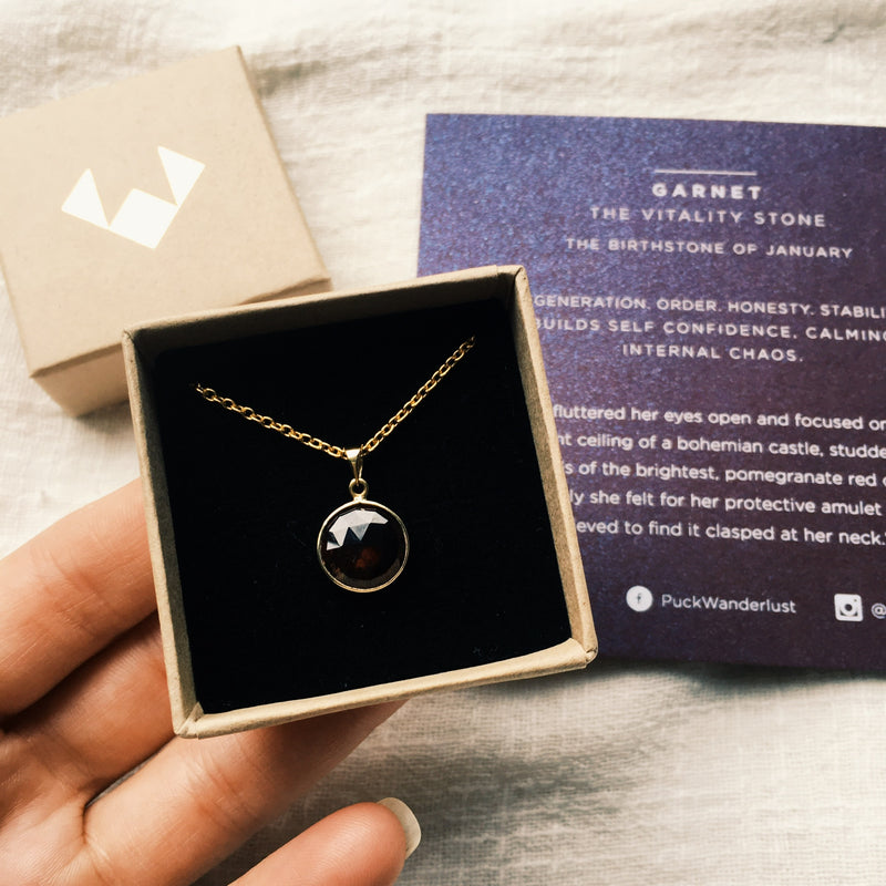 Puck Wanderlust_Gold January Garnet Birthstone Charm Necklace_Packaging