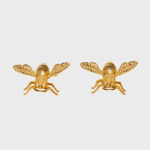 gold moth clip earrings front