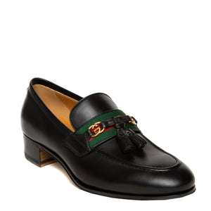 black leather Gucci loafers outer angle