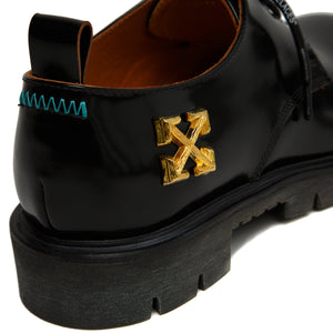 gold arrows black leather derby shoe close-up heel